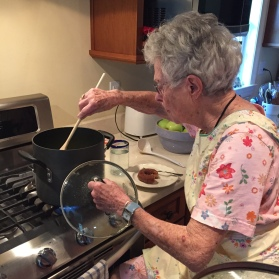 Mom stirring applesauce June 2016